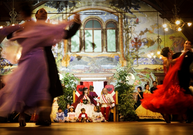 "ITALY. Trentino. 2010. In Madonna di Campiglio, during the Habsburg Carneval, dancers enjoying themselves as the ""Royal Court"" sits and looks on."
